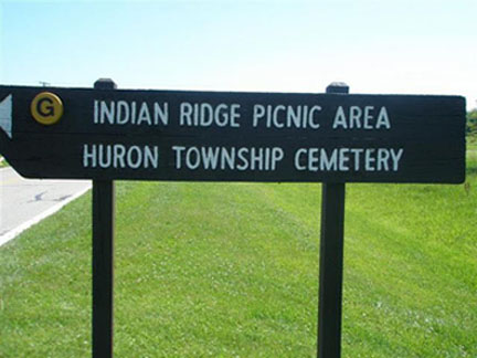 Sign Showing The Direction To Cemetery
